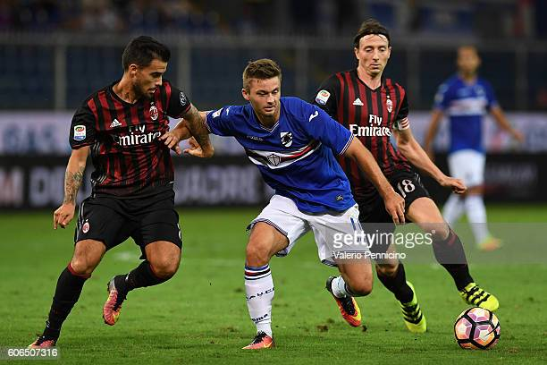 Karol Linetty of UC Sampdoria competes with Fernandez Suso of AC Milan during the Serie A match between UC Sampdoria and AC Milan at Stadio Luigi...