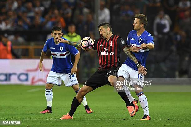 Karol Linetty of UC Sampdoria competes with Jose Sosa of AC Milan during the Serie A match between UC Sampdoria and AC Milan at Stadio Luigi Ferraris...