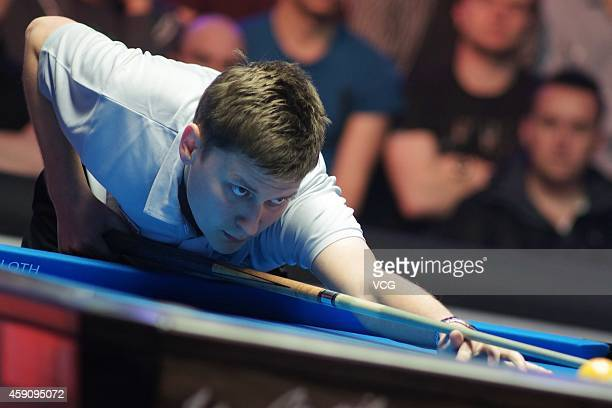 Karol Skowerski of Poland plays a shot against Nikos Ekonomopoulos of Greece during semifinal of Partypoker World Pool Masters 2014 on November 16...