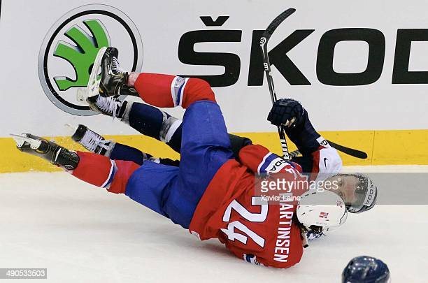 Karol Sloboda of Slovakia is slashed by Andreas Martinsen of Norway during the 2014 IIHF World Championship between Slovakia and Norway at Chizhovka...