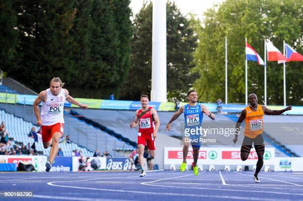 Karol Zalewski of Poland Stanislau Darahakupets of Belarus Antonio Infantino of Italy and Solomon Bockarie of Netherlands compete in the Men's 200m...