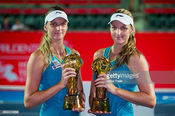 Karolina and Kristyna Pliskova of Czech Republic pose with the trophy after winning the doubles final match during the Hong Kong Tennis Open against...