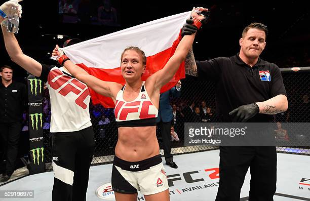 Karolina Kowalkiewicz celebrates her victory over Heather Jo Clark in their women's strawweight bout during the UFC Fight Night event at Ahoy...