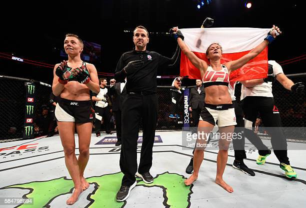 Karolina Kowalkiewicz celebrates her victory over Rose Namajunas in their women's strawweight bout during the UFC 201 event on July 30 2016 at...