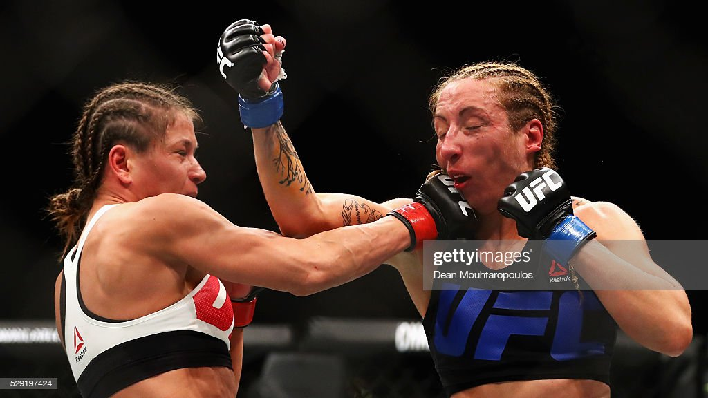 Karolina Kowalkiewicz (L) of Poland and Heather Jo Clark of the USA compete in their Women's Strawweight bout during the UFC Fight Night 87 at Ahoy on May 8, 2016 in Rotterdam, Netherlands.
