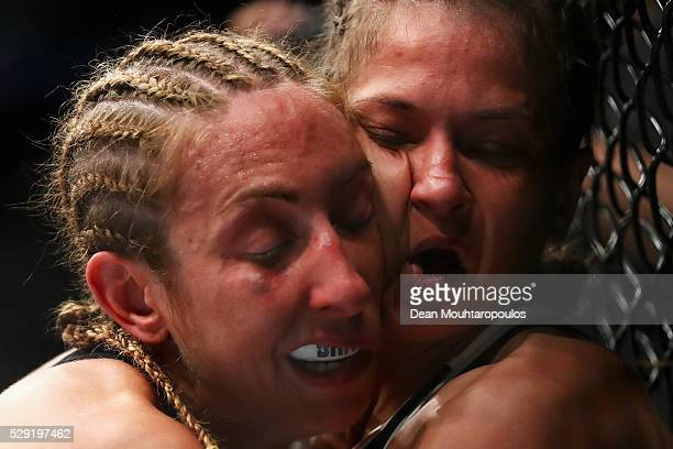Karolina Kowalkiewicz of Poland and Heather Jo Clark of the USA compete in their Women's Strawweight bout during the UFC Fight Night 87 at Ahoy on...
