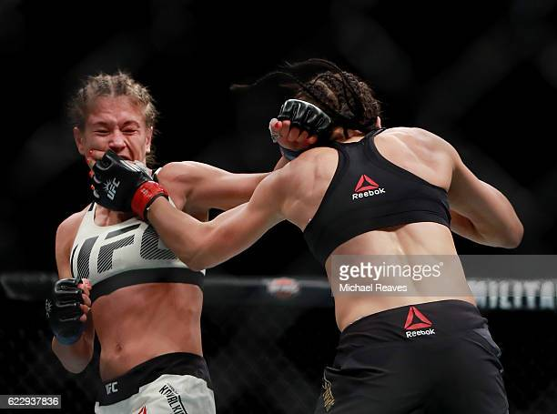 Karolina Kowalkiewicz of Poland fights against Joanna Jedrzejczyk of Poland in their women's strawweight championship bout during the UFC 205 event...