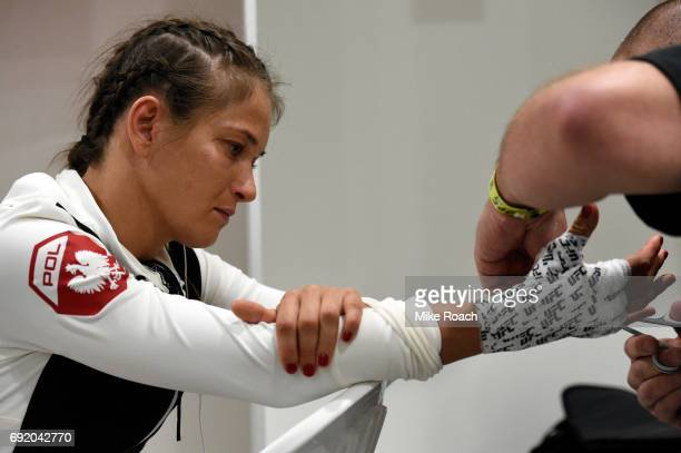 Karolina Kowalkiewicz of Poland has her hands wrapped in her locker room prior to her bout against Claudia Gadelha of Brazil during the UFC 212 event...