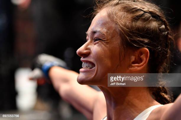 Karolina Kowalkiewicz of Poland prepares to enter the Octagon prior to her womens strawweight bout against Claudia Gadelha of Brazil during the UFC...