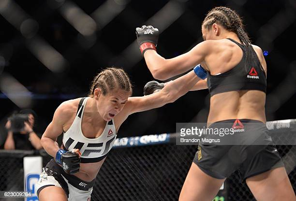 Karolina Kowalkiewicz of Poland punches Joanna Jedrzejczyk of Poland in their UFC women's strawweight championship fight during the UFC 205 event at...