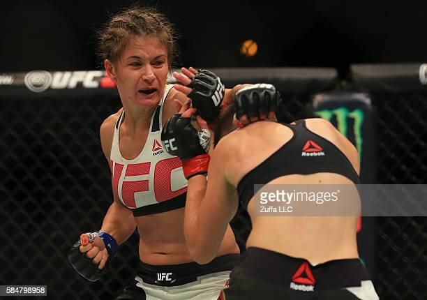 Karolina Kowalkiewicz of Poland punches Rose Namajunas in their women's strawweight bout during the UFC 201 event on July 30 2016 at Philips Arena in...