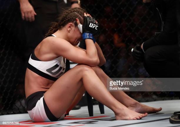 Karolina Kowalkiewicz of Poland reacts after her submission loss to Claudia Gadelha of Brazil in their womens strawweight bout during the UFC 212...