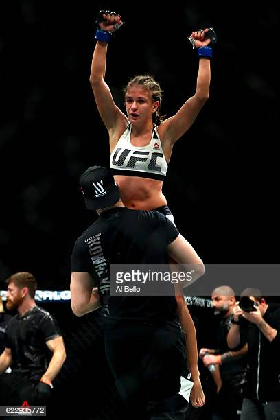 Karolina Kowalkiewicz of Poland reacts after her women's strawweight championship bout with Joanna Jedrzejczyk of Poland during the UFC 205 event at...