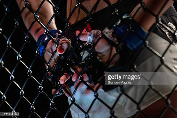 Karolina Kowalkiewicz of Poland rests in her corner between rounds of her UFC women's strawweight title fight against Joanna Jedrzejczyk during the...