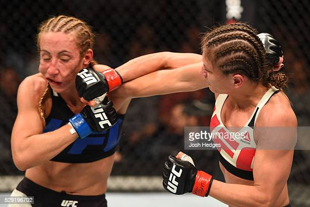 Karolina Kowalkiewicz punches Heather Jo Clark in their women's strawweight bout during the UFC Fight Night event at Ahoy Rotterdam on May 8 2016 in...