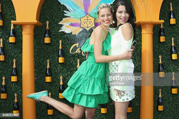 Karolina Kurkova and Adriana Lima attend the Third Annual Veuve Clicquot Carnaval at Museum Park on March 4 2017 in Miami Florida