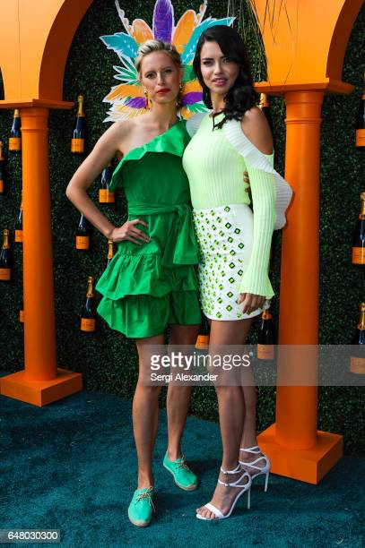 Karolina Kurkova and Adriana Lima attend Veuve Clicquot hosts Third Annual Clicquot Carnaval supporting the Perez Art Museum Miami in Museum Park on...