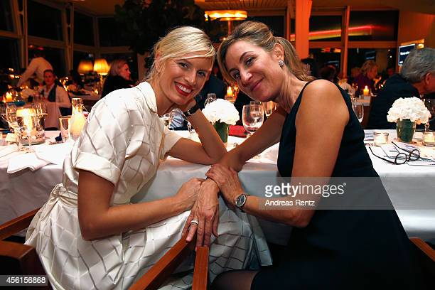 Karolina Kurkova and Carolina MuellerMoehl attend the Women of Impact Reception during Day 2 of Zurich Film Festival 2014 on September 26 2014 in...