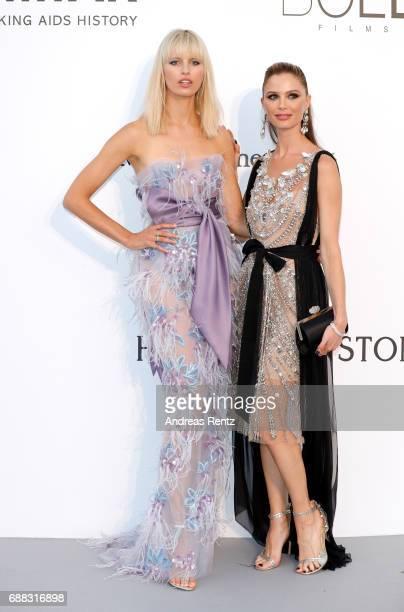 Karolina Kurkova and Georgina Chapman arrive at the amfAR Gala Cannes 2017 at Hotel du CapEdenRoc on May 25 2017 in Cap d'Antibes France