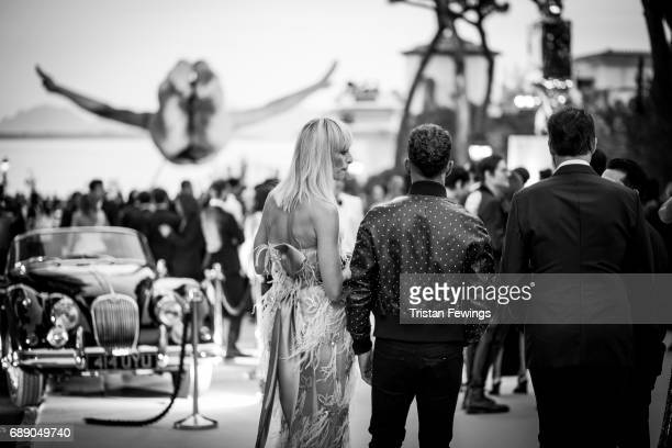 Karolina Kurkova and Lewis Hamilton attend the amfAR Gala Cannes 2017 at Hotel du CapEdenRoc on May 25 2017 in Cap d'Antibes France
