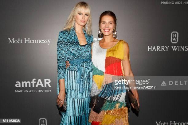 Karolina Kurkova and Margherita Missoni walk the red carpet at the amfAR Gala Milano on September 21 2017 in Milan Italy