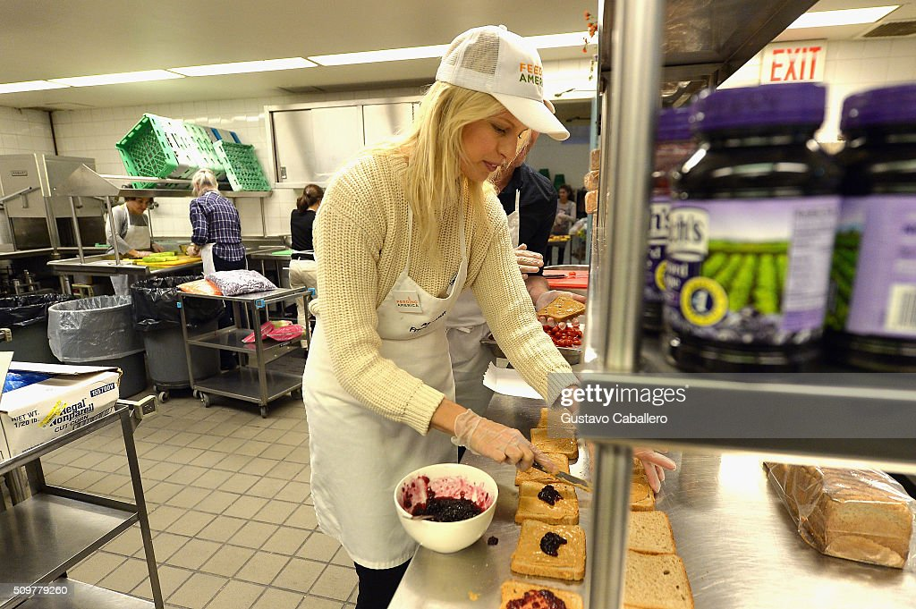 <a gi-track='captionPersonalityLinkClicked' href=/galleries/search?phrase=Karolina+Kurkova&family=editorial&specificpeople=202513 ng-click='$event.stopPropagation()'>Karolina Kurkova</a> attands the Feeding America's Pledge To Volunteer Event At All Souls Friday Soup Kitchen on February 12, 2016 in New York City.