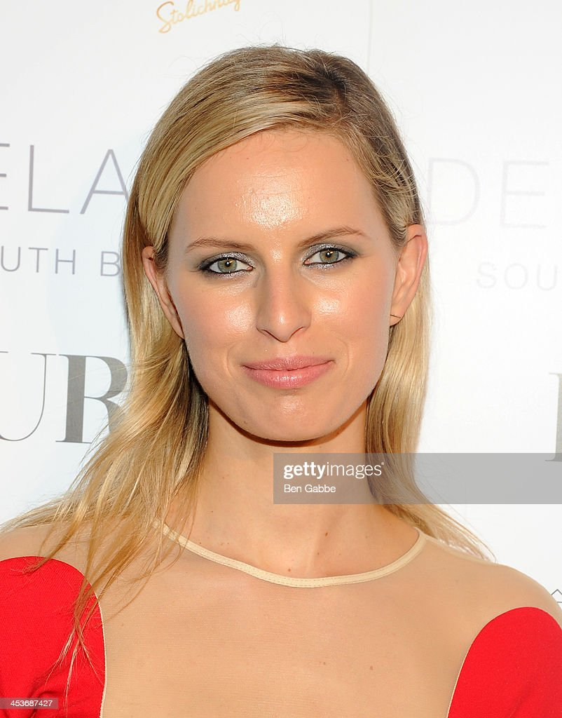 Karolina Kurkova attends DuJour Magazine's event to honor artist Marc Quinn at Delano South Beach Club on December 4, 2013 in Miami Beach, Florida.