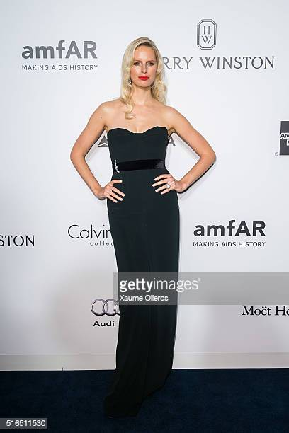 Karolina Kurkova attends the 2016 amfAR Hong Kong gala with a guest at Shaw Studios on March 19 2016 in Hong Kong Hong Kong