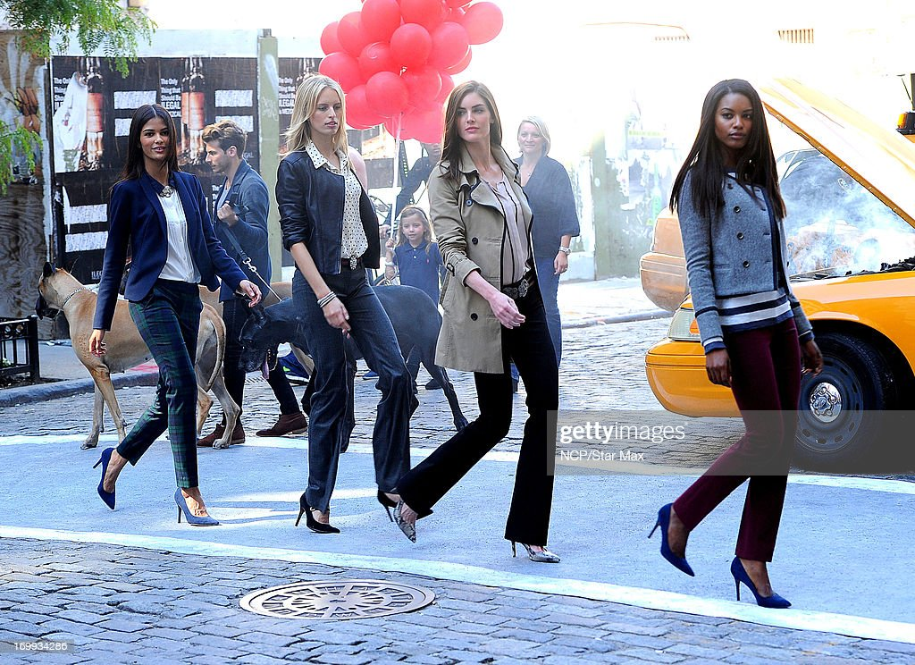 Karolina Kurkova (2nd from L), Hilary Rhoda (3rd from L) and models sighting in East Village on June 4, 2013 in New York City.