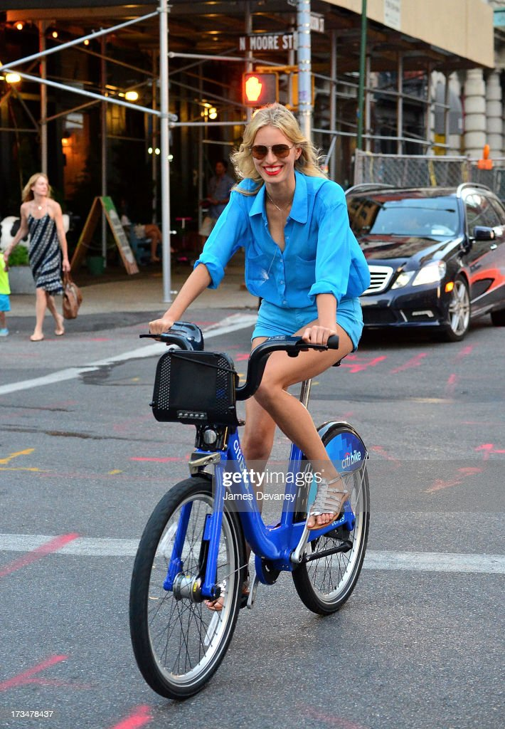 Karolina Kurkova rides a CitiBike on the streets of Manhattan on July 14, 2013 in New York City.