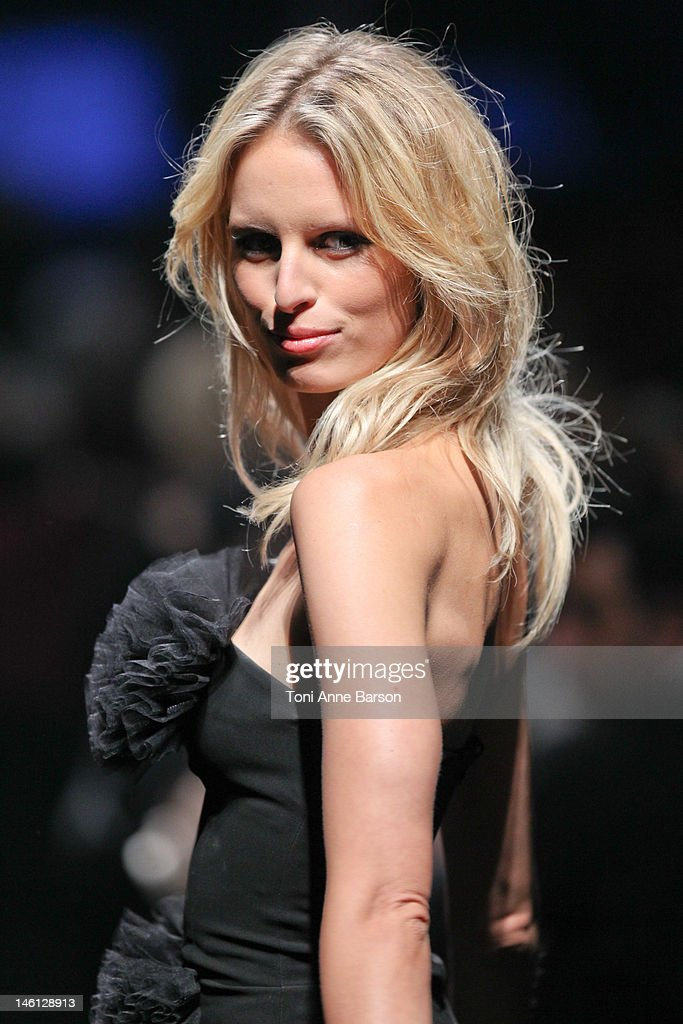 <a gi-track='captionPersonalityLinkClicked' href=/galleries/search?phrase=Karolina+Kurkova&family=editorial&specificpeople=202513 ng-click='$event.stopPropagation()'>Karolina Kurkova</a> walks the runway during amfAR's Cinema Against AIDS auction at Hotel Du Cap on May 24, 2012 in Antibes, France.
