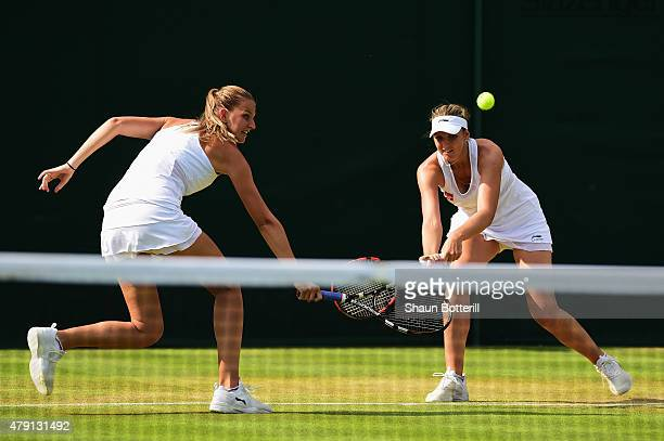 Karolina Pliskova of Czech Republic and Kristyna Pliskova of Czech Republic return a shot in their Ladies Doubles First Round match against Monica...
