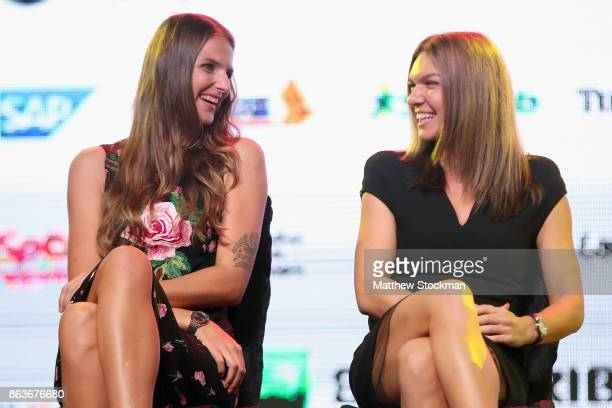Karolina Pliskova of Czech Republic and Simona Halep of Romania talk to one another on the stage during the Official Draw Ceremony and Gala of the...