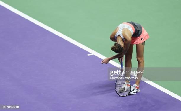 Karolina Pliskova of Czech Republic bows her head in her singles semi final match against Caroline Wozniacki of Denmark during day 7 of the BNP...