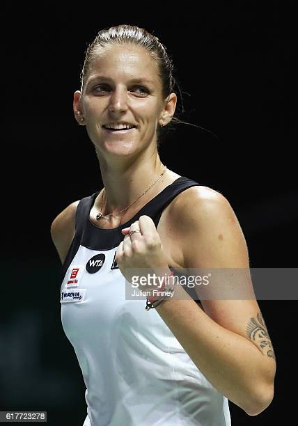 Karolina Pliskova of Czech Republic celebrates victory in her singles match against Garbine Muguruza of Spain during the BNP Paribas WTA Finals...