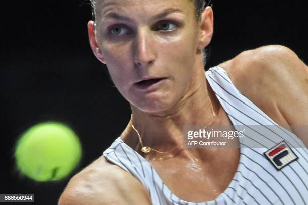 Karolina Pliskova of Czech Republic hits a return against Jelena Ostapenko of Latvia during the WTA Finals tennis tournament in Singapore on October...