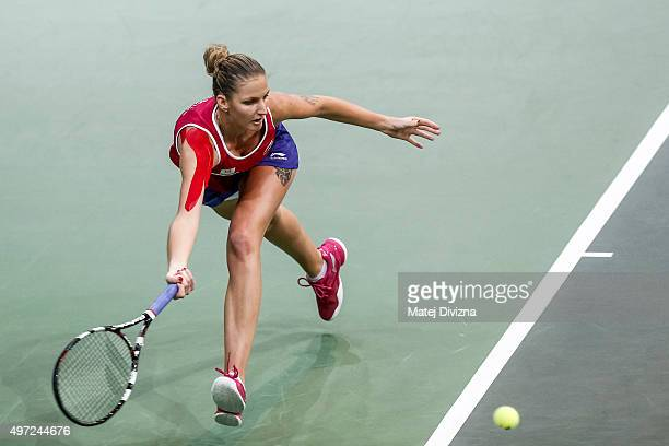 Karolina Pliskova of Czech Republic in action against Anastasia Pavlyuchenkova of Russia during day two of the Fed Cup final match between Czech...