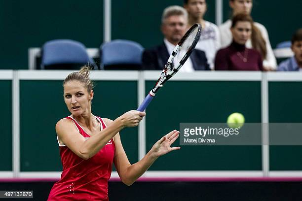 Karolina Pliskova of Czech Republic in action against Maria Sharapova of Russia during day one of the Fed Cup final match between Czech Republic and...