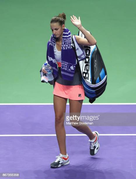Karolina Pliskova of Czech Republic leaves the court after her defeat in the singles semi final match against Caroline Wozniacki of Denmark during...