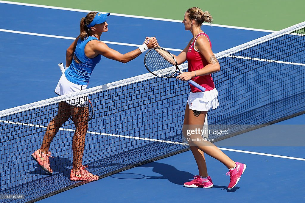 Karolina Pliskova of Czech Republic left congratulates Lesia Tsurenko of Ukraine after their match on Day 4 of the Connecticut Open at Connecticut...