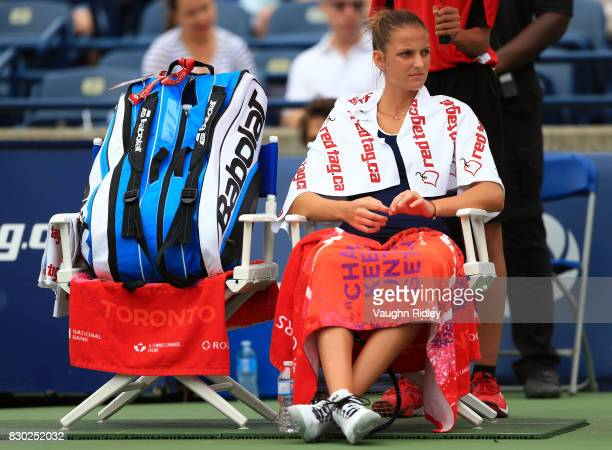 Karolina Pliskova of Czech Republic looks on as the start of her match against Caroline Wozniacki of Denmark is delayed due to rain during Day 7 of...