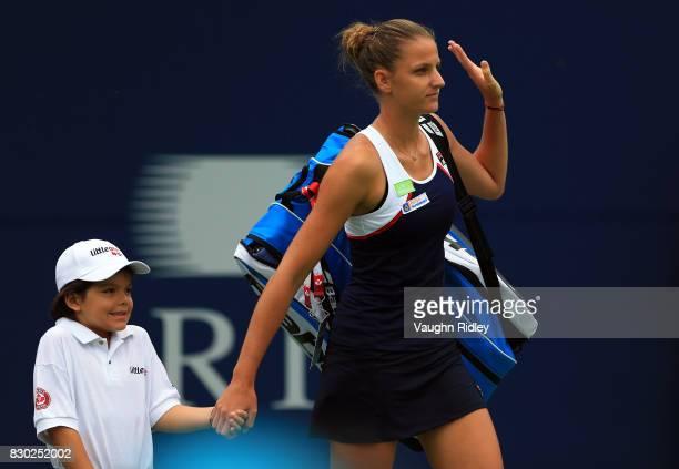 Karolina Pliskova of Czech Republic makes her way onto the court prior to her match against Caroline Wozniacki of Denmark during Day 7 of the Rogers...