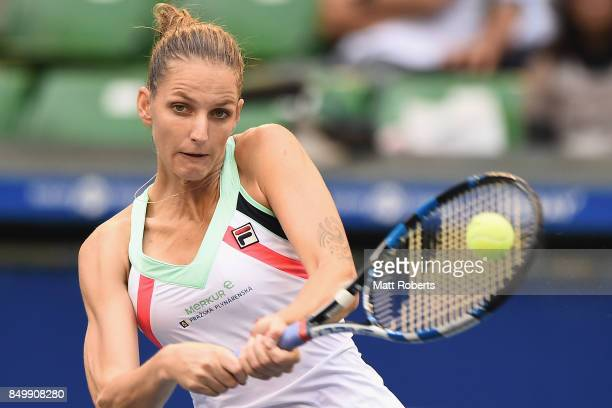Karolina Pliskova of Czech Republic plays a backhand against Magda Linette of Poland during day three of the Toray Pan Pacific Open Tennis At Ariake...
