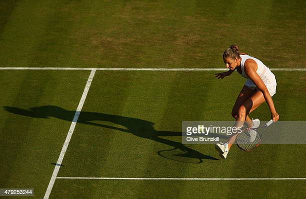 Karolina Pliskova of Czech Republic plays a backhand during her Women's Singles Second Round match againstSvetlana Kuznetsova of Russia during day...