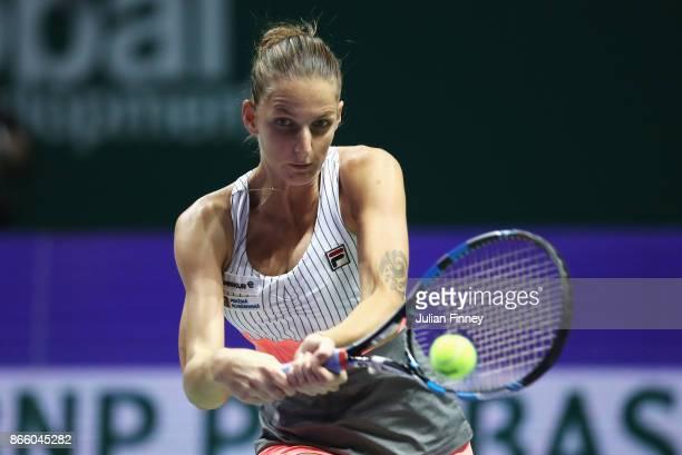 Karolina Pliskova of Czech Republic plays a backhand in her singles match against Garbine Muguruza of Spain during day 3 of the BNP Paribas WTA...