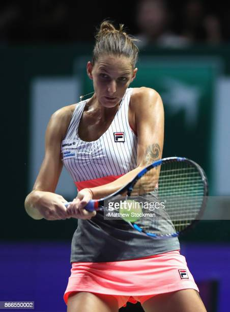 Karolina Pliskova of Czech Republic plays a backhand in her singles match against Jelena Ostapenko of Latvia during day 5 of the BNP Paribas WTA...