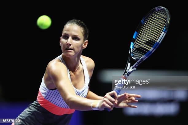 Karolina Pliskova of Czech Republic plays a backhand in her singles semi final match against Caroline Wozniacki of Denmark during day 7 of the BNP...