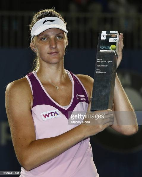 Karolina Pliskova of Czech Republic poses with her trophy after winning the Singles Final match against Bethanie MattekSands of USA during the 2013...
