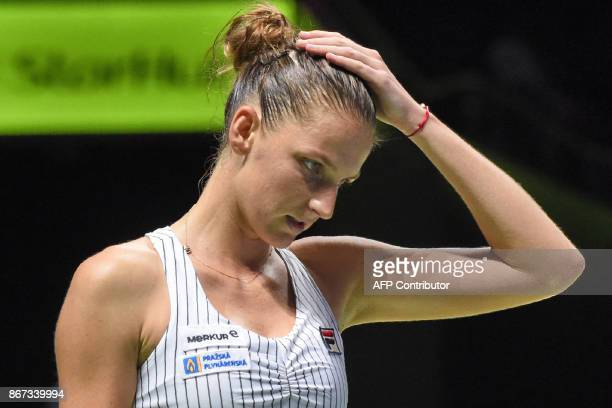 Karolina Pliskova of Czech Republic reacts after a point against Caroline Wozniacki of Denmark during the WTA Finals tennis tournament in Singapore...