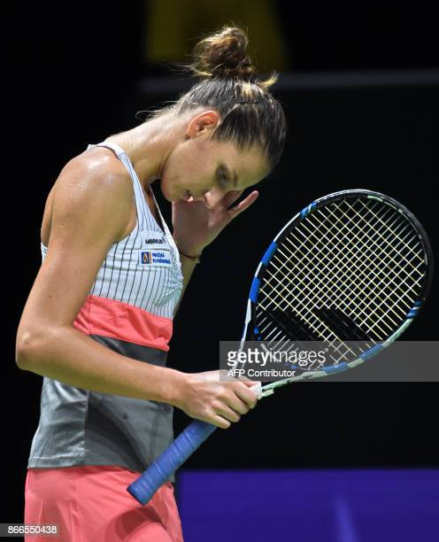 Karolina Pliskova of Czech Republic reacts to a point in a match against Jelena Ostapenko of Latvia during the WTA Finals tennis tournament in...